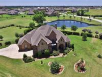 Striking custom home on 1-acre in a nice gated
