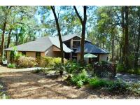 RENOVATED -Beautifully designed Custom Home - nestled