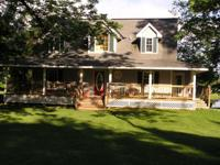 Custom built 4br 3 1/2 bath, on three quite wooded