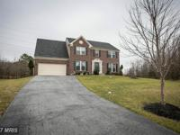 Welcome home! This 4 bedroom 3 and 1/2 bath home