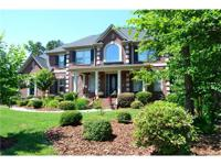 Stunning full brick home located on a .73 acre