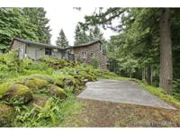Beautiful custom home in a private wooded setting. Dual