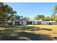 Lake Magdalene Shore Estates renovated pool home with 4