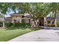 Beautifully upgraded lake view pool home! Prestigious