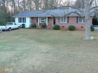Great four sided brick ranch in the heart of Commerce