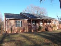 This one has it all! Beautiful 4/3 brick home on 1 acre