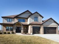 This Immaculate 2 year old, custom built (4 bedrooms