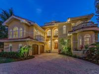 This magnificent custom, two story 4 BR + Den 3  BA