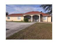 Beautiful pool home over an acre corner lot. Property