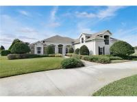 5 acre custom built home in exclusive gated community -