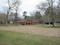 Approximately 2.5 acres with 4 bedrooms, 3 bathrooms.