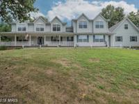 A showcase home on 1.29 acres w/ in ground salt water