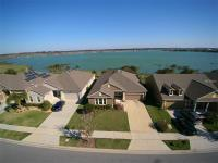 Darling home on 1/3 Acre Lakefront lot! This modified
