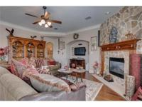 Immaculate home in gated community on over 3rd acre!
