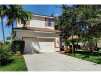 Lake front pool home situated in desirable Coral Lakes!