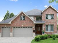 Spectacular brick & stone traditional two story home
