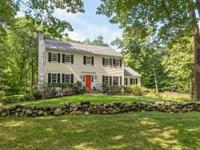 Meticulously updated center hall colonial, situated on