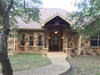 One story stone home with gated entrance on over one