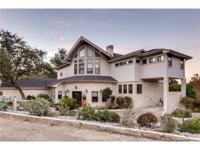 Gorgeous home on 1+ acre w/lake views. Tiered decking