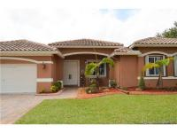 This beautiful corner home is located at windsor palms