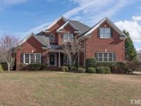 Luxurious living in this stunning custom all brick