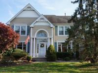 Exquisite! One of a kind center hall colonial offered