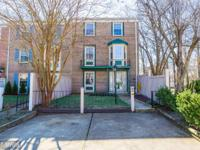 Fantastic end-unit 4BR/3BA brick townhouse backing to