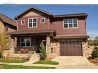 Immaculate 2 story, south facing model home features a
