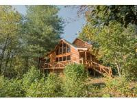 Custom log sided home with 4 bedrooms & 3 baths. 3.29