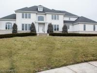 Welcome home to 5 Colts Ct. Situated on a private
