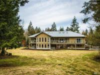 Enjoy privacy and luxury living on 4.8 acres in this