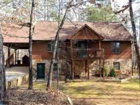 Uniquely charming, cedar & stone rancher is close to