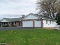 Updated all brick rancher featuring 4 br, 3 full & 2