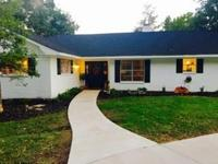 Welcome home! Beautiful, 4 bed 3 bath remodeled brick