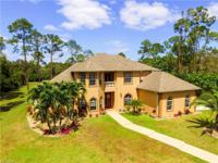 Custom gated estate home with many features and
