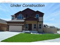 This Delmon floor plan home is 2101 finished sq ft w/