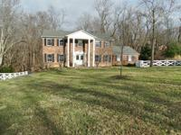 Beautiful two story brick home on wooded, private lot.