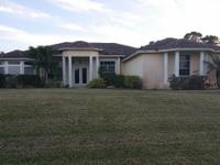 Large Home On Over An Acre Of Land Located In Palm