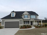 Gorgeous two story home with grand two story foyer in