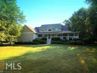 Southern Living Tranquility!Nestled amongst 11.2 Acres,