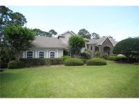 Custom Lakefront beauty on over 5 acres. A hidden gem &