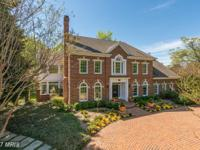 Stunning custom all brick colonial located on a quiet