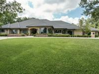 Spectacular one story home on oversized cul-de-sac lot.