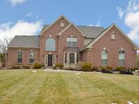 Amazing home in sought after Cherry Brook on wooded