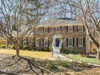4BR/4BA brick sided home with updated kitchen w/granite