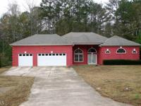 This exquisite Custom Built 4-bedroom 4-bath Ranch with