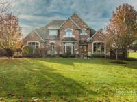 This stunning brick & stone home is set on a