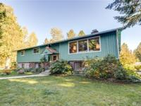 Large home in very desirable area. Shop and barn with