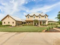 Gorgeous stone estate home w-metal roof on nearly 40