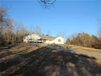 Beautiful and spacious brick front home on 7.3 acres